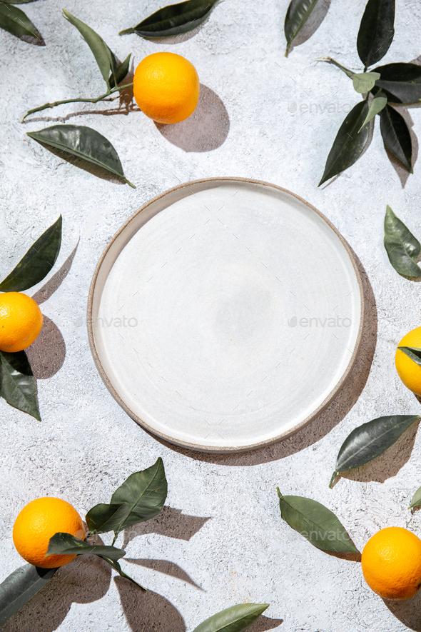 Whole oranges witl orange tree leaves on white background - Stock Photo - Images