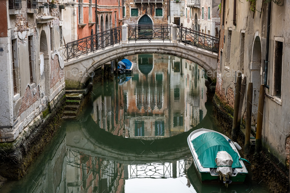 Tranquil scene in one of the small canals in Venice - Stock Photo - Images