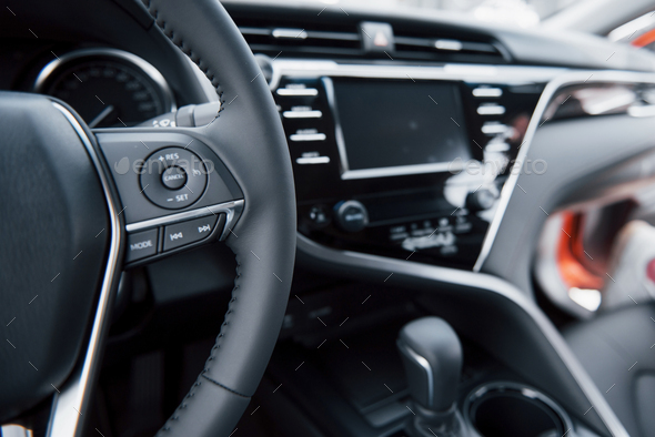 View of the interior of a modern automobile showing the dashboard - Stock Photo - Images