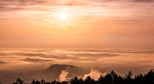 Panorama of Graz city in Styria on autumn morning during sunraise above fog - Stock Photo - Images
