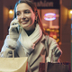 Happy woman doing Christmas shopping and talking on the phone - PhotoDune Item for Sale