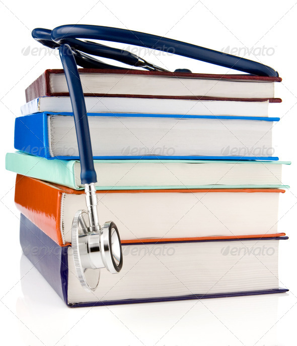 books and stethoscope isolated on white background - Stock Photo - Images