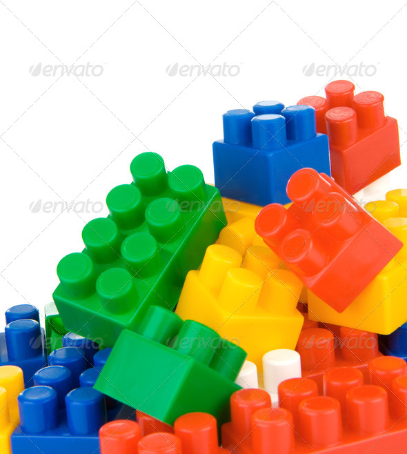 colorful plastic toys and bricks isolated on white - Stock Photo - Images