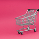 Black cart store trolley over pink background design for black friday - PhotoDune Item for Sale