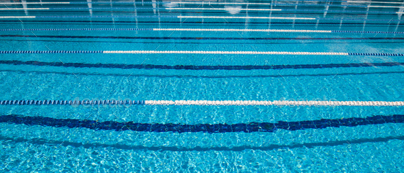 Olympic Swimming pool background on a bright Sunny day - Stock Photo - Images