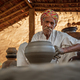 Potter at work makes ceramic dishes. India, Rajasthan. - PhotoDune Item for Sale