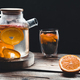 Citrus tea in a transparent teapot and a glass, healthy drink on a wooden background - PhotoDune Item for Sale