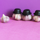 Garlic family characters on violet purple background. - PhotoDune Item for Sale