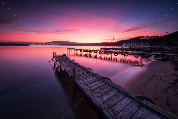 Sea sunset above wooden piers - Stock Photo - Images