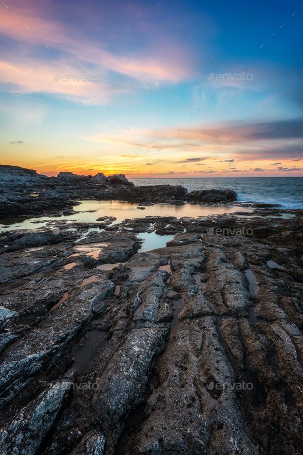 Sea sunrise at rocky beach - Stock Photo - Images