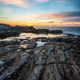 Sea sunrise at rocky beach - PhotoDune Item for Sale