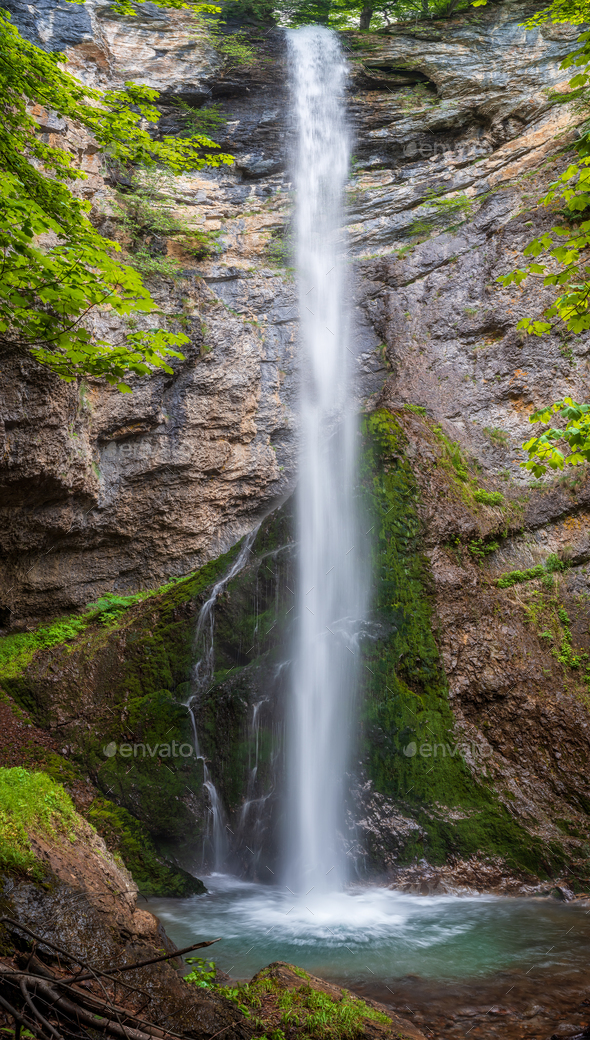 Waterfall in a spring mountain - Stock Photo - Images
