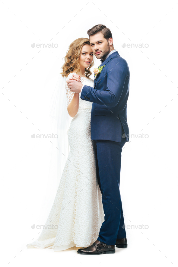 young bride and groom dancing together isolated on white - Stock Photo - Images