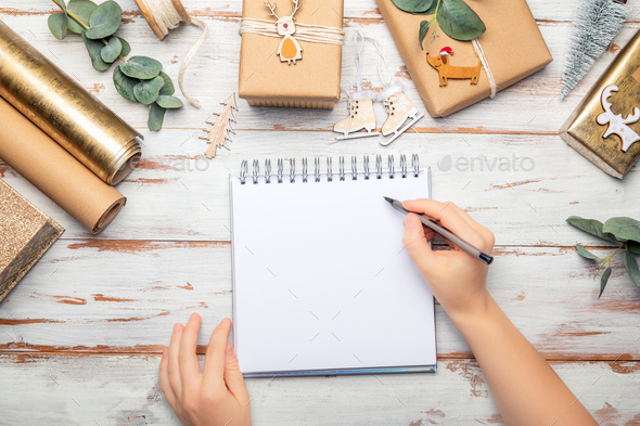 Notebook for writing Xmas manifests - Stock Photo - Images