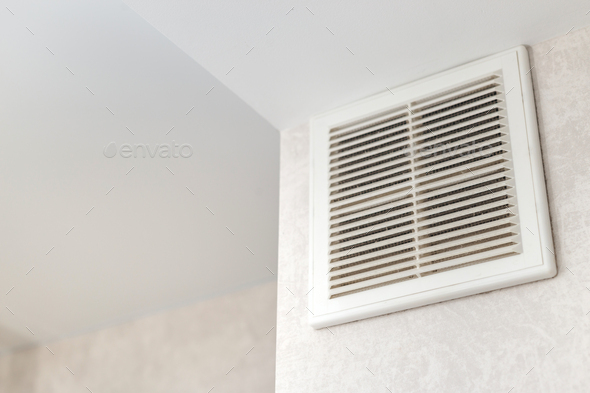 Dirty ventilation grille in the kitchen on the wall. Communication in the kitchen. - Stock Photo - Images