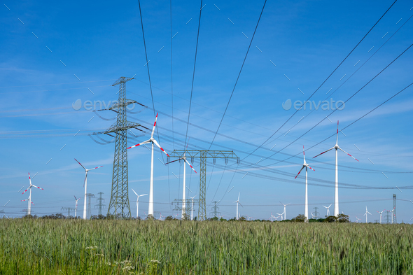 Power lines, electricity pylons and wind turbines - Stock Photo - Images