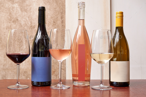 Three different kind of bottles of wine and three glasses - Stock Photo - Images