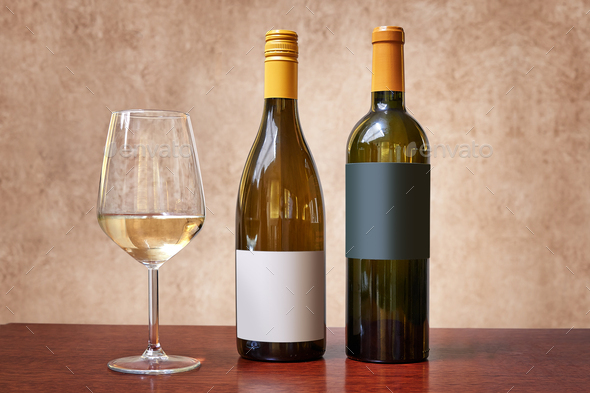 Two different kind of bottles of white wine and one glass - Stock Photo - Images