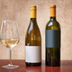 Two different kind of bottles of white wine and one glass - PhotoDune Item for Sale