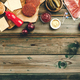 Raw beef patties, sesame buns with other ingredients for hamburgers on wooden background - PhotoDune Item for Sale