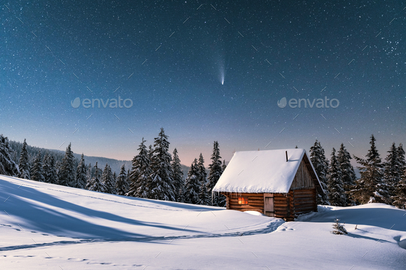 Fantastic winter landscape with wooden house in snowy mountains - Stock Photo - Images