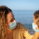 Happy mother and daughter wearing medical mask outdoor - PhotoDune Item for Sale
