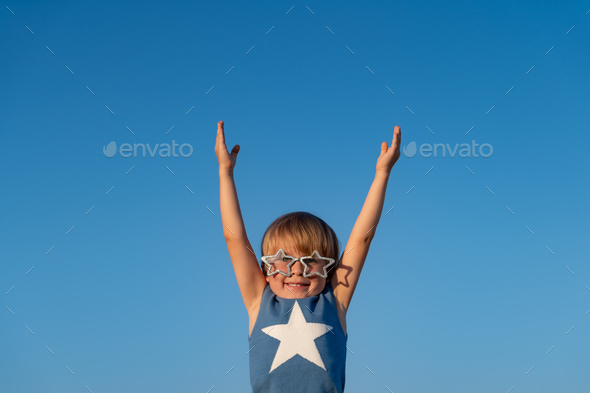 Happy child playing outdoor - Stock Photo - Images