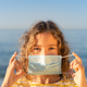 Happy child wearing medical mask outdoor - PhotoDune Item for Sale