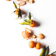 Oranges fruits composition with green leaves and slice on white wooden background, top view - PhotoDune Item for Sale