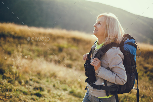 Senior woman hiking - Stock Photo - Images
