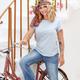 Young women with bycicle stays near stairs - PhotoDune Item for Sale