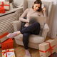 Young woman shopping online with credit card and laptop in armchair - PhotoDune Item for Sale