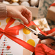 Woman wrapping Christmas gifts presents at home - PhotoDune Item for Sale