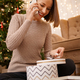 Woman talk on phone while sitting between gifts for her family and friends - PhotoDune Item for Sale