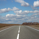 Asphalt Road And Clouds On Blue Sky In Sunny Day - PhotoDune Item for Sale