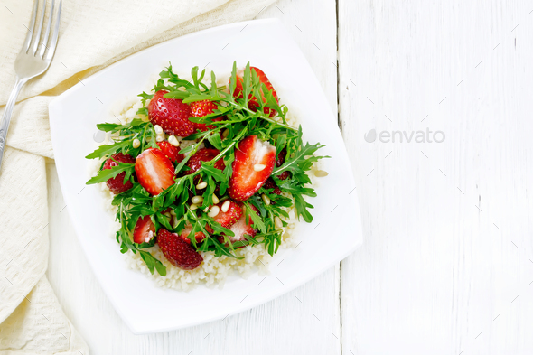 Salad of strawberry and couscous on light board top - Stock Photo - Images