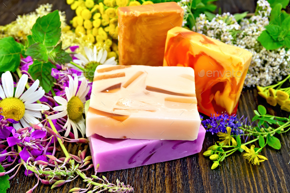 Soap homemade with flowers on board - Stock Photo - Images