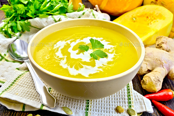 Soup-puree pumpkin with cream in bowl on napkin - Stock Photo - Images