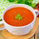 Soup tomato in bowl with spoon on board - PhotoDune Item for Sale