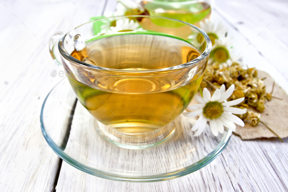 Tea chamomile in cup on light board - Stock Photo - Images