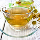 Tea chamomile in cup on light board - PhotoDune Item for Sale