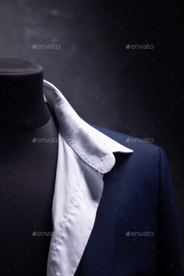 suit jacket and shirt on male tailor mannequin - Stock Photo - Images