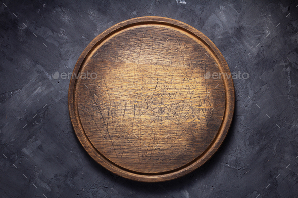 pizza cutting board at  table or wall - Stock Photo - Images