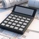 Calculator on blueprint plans background.  Construction budget concept. 3d illustration - PhotoDune Item for Sale