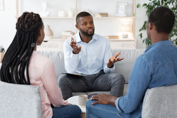 Family Psychotherapy. African American Couple Listening To Counselor's Advices During Therapy - Stock Photo - Images