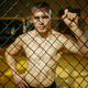 Male MMA fighter standing at the grid in a cage - PhotoDune Item for Sale