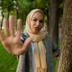 Arab girl in hijab shows her palm in summer park - PhotoDune Item for Sale