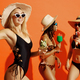 Three sexy women in swimsuits poses with coctails - PhotoDune Item for Sale