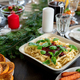 Festive table served with pasta, roasted turkey, plates, candles and others - PhotoDune Item for Sale