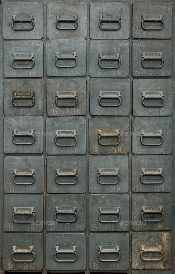 Old gray metal cabinet with drawers - Stock Photo - Images